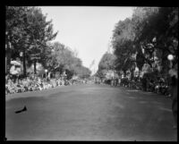 View of the start of the Tournament of Roses Parade route on S. Orange Grove Blvd. towards Goodhue Flagpole, Pasadena, 1929