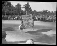Two women carrying a banner announcing the start of the Tournament of Roses Parade, Pasadena, 1929