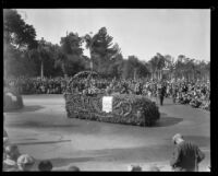 Automobile carrying Liutenant Governor H. L. Carnahan and Tournament of Roses President C. Hal Reynolds in the Tournament of Roses Parade, Pasadena, 1930
