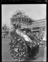 Woman riding in a floral cart at the Tournament of Roses Parade, Pasadena, 1930