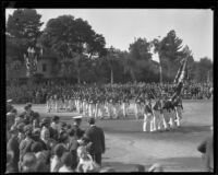 Marching soldiers carrying rifles in the Tournament of Roses Parade, Pasadena, 1930