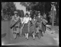 Spectators leaving the Tournament of Roses Parade, Pasadena, 1930