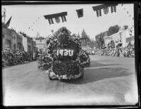 "Float with a foral sign reading ""1930"" in the Tournament of Roses Parade, Pasadena, 1930"