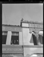 Rose Parade spectators in 2nd floor window at 42 W. Colorado Blvd., Pasadena, 1930