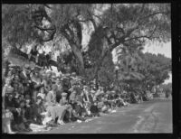 Rose Parade spectators on Orange Grove Blvd., Pasadena, 1930