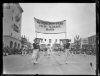 "Young women carrying the ""Huntington Park High School Band"" banner in the Tournament of Roses Parade, Pasadena, 1931"