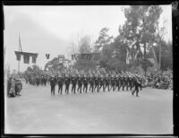 Marching soldiers carrying rifles followed by color guard in the Tournament of Roses Parade, Pasadena, 1930    in the Tournament of Roses Parade, Pasadena, 1931