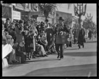 Street vendor selling football related mementos at the Tournament of Roses Parade, Pasadena, 1932