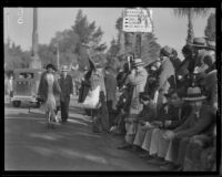 Street vendor selling seat cushions at the Tournament of Roses Parade, Pasadena, 1932