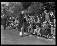 Spectators seated along the route of the Tournament of Roses Parade, Pasadena, 1932