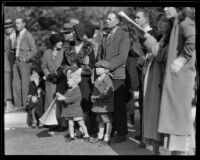 Family and other spectators at the Tournament of Roses Parade, Pasadena, 1932