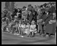 Children with curb-front seats on the route of the Tournament of Roses Parade, Pasadena, 1932