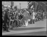 Food vendor selling crispettes pop corn confection to spectators on the route of the Tournament of Roses Parade, Pasadena, 1932