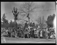 Boys in tree on the route of the Tournament of Roses Parade, Pasadena, 1932