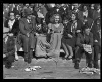 Spectators seated curb-side at the Tournament of Roses Parade, Pasadena, 1932