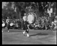 Drummer leading the Pasadena Bag Pipe Band in the Tournament of Roses Parade, Pasadena, 1932