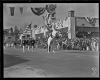 Officer on a rearing white horse in the Tournament of Roses Parade, Pasadena, 1932
