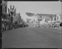 View of the Rose parade on Colorado Blvd. facing west from Marengo Ave., Pasadena, 1933