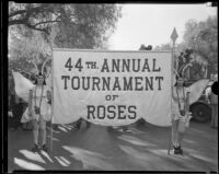 Two girls dressed as butterflies carrying the banner announcing the Tournament of Roses Parade, Pasadena, 1933