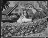 "Little girl on the ""A Midsummer Night's Dream"" float in the Tournament of Roses Parade, Pasadena, 1935"