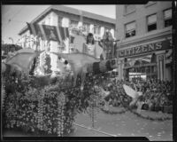 """Butterflies on the """"Queen of the Fairies"""" float in the Tournament of Roses Parade, Pasadena, 1933"""