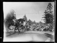 Four horseback riders in Spanish-style costumes in the Tournament of Roses Parade, Pasadena, 1935