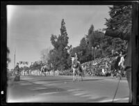 Three men on horseback in the Tournament of Roses Parade, Pasadena, 1935