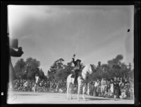 Woman on horseback waving to the crowd at the Tournament of Roses Parade, Pasadena, 1935