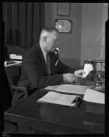 Los Angeles police detective Joe Taylor working at desk, 1931