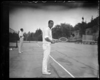 Norval Craig standing with tennis racket, Midwick Country Club, Alhambra, 1925