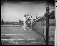 Harvey Snodgrass and Walter Wesbrook shaking hands on tennis court, Midwick Country Club, Alhambra, 1925