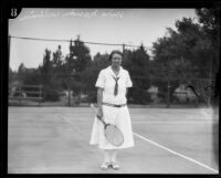 Marion Williams standing with tennis racket, Midwick Country Club, Alhambra, 1925