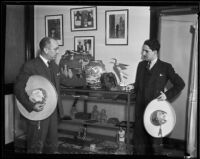 Mexican consul Joaquin Terrazas and Victor Manuel Pesqueira with Mexican art, 1935