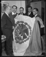 Mexican consul Joaquin Terrazas presenting Mexican flag to members of the Mexican Chamber of Commerce, Los Angeles, 1935
