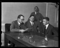 Dr. Martin G. Carter and Judge Walter S. Gates study the case of 7-year-old Alsa Thompson, Los Angeles, 1925