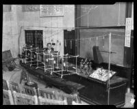 Dr. Roland R. Tileston with his atom model apparatus, Claremont, 1925