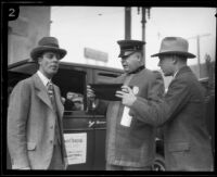 Police Chief Wilfred Spellman with stunt driver Hayward Thompson, Los Angeles, 1927