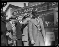 Stunt driver Hayward Thompson getting his blindfold checked, Los Angeles, 1927