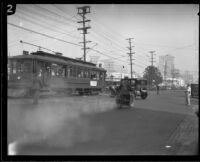 Police officer follows Hayward Thompson as he drives through traffic, Los Angeles, 1927