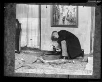 John Fraser searches through the rubble left from the bombing, Glendale, 1924