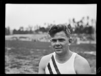 Joe Forbes, Occidental College track athlete, poses at Patterson Field during a track meet, Los Angeles, 1932