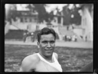 Don Plumb, Pomona College sprinter, relaxes on Patterson Field during a track meet, Los Angeles, 1932
