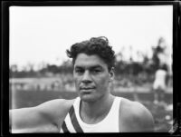 Dick Finley, Occidental College track athlete, poses at Patterson Field during a track meet, Los Angeles, 1932