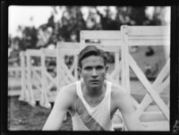 Dray Williams, Pomona College hurdler, poses at Patterson Field during a track meet, Los Angeles, 1932