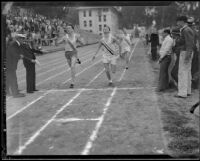 Dick Pollard of Pomona College noses out Mel Caldwell of Occidental College to win the 880-yard race during a dual track meet, Los Angeles, 1932
