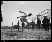 Pacific Fleet athlete broad jumps during the Fleet's track championship meet, Long Beach, 1922