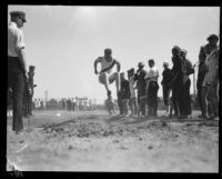 Pacific Fleet broad jumper competes during the championship track meet, Long Beach, 1922