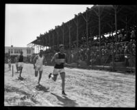 Runners race during the Pacific Fleet championship track meet, Long Beach, 1922