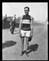 Track athlete poses during the Pacific Fleet championship track meet, Long Beach, 1922