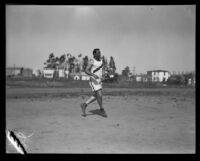 Pacific Fleet track and field athlete stands on the competition field, Long Beach, 1922
